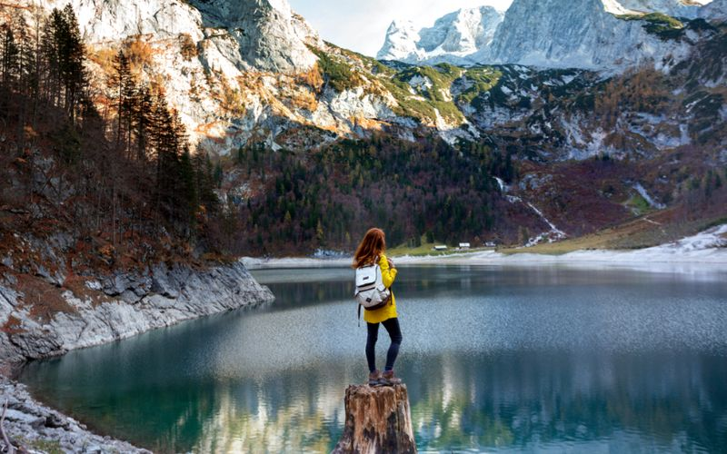 Girl standing in front of a lake in Canada