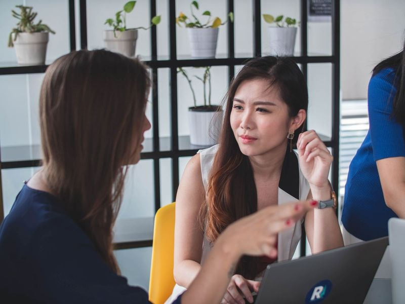 Beautiful Asian woman having a conversation