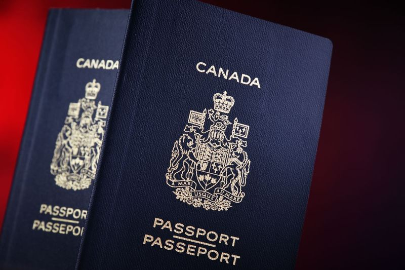 Canadian passports on red background | immigrate to Canada