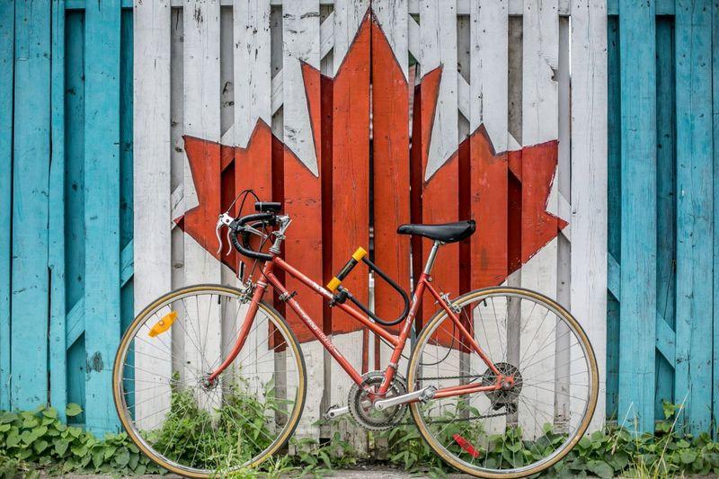 Canada-Bicycle-Maple-Leaf-IEC Canada Work Permit