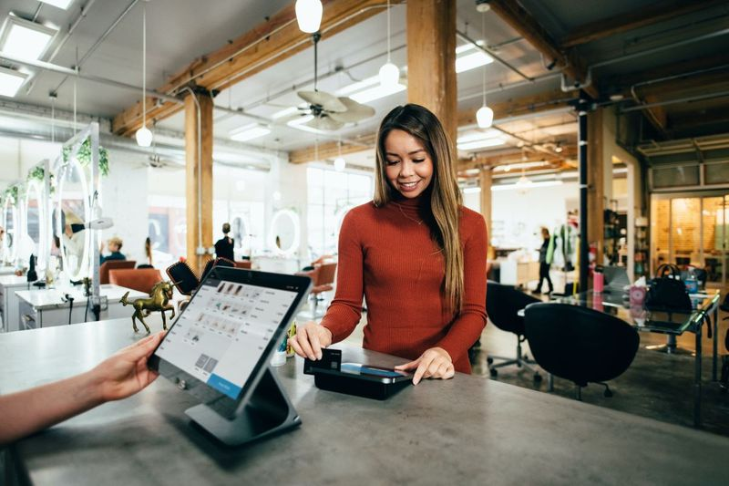 Girl paying with a credit card at a store