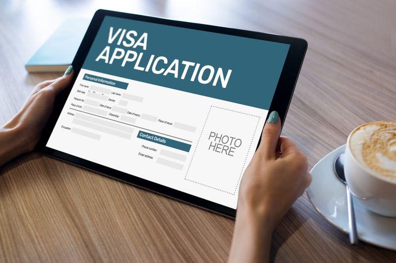 Online Skilled Worker Visa application form on tablet screen for Canada