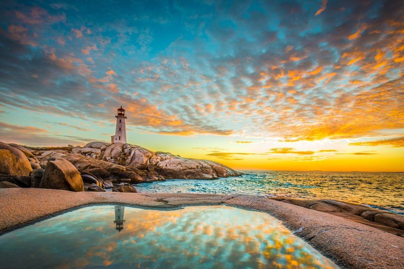 Peggy's cove lighthouse sunset ocean view landscape in Halifax Nova Scotia Canada