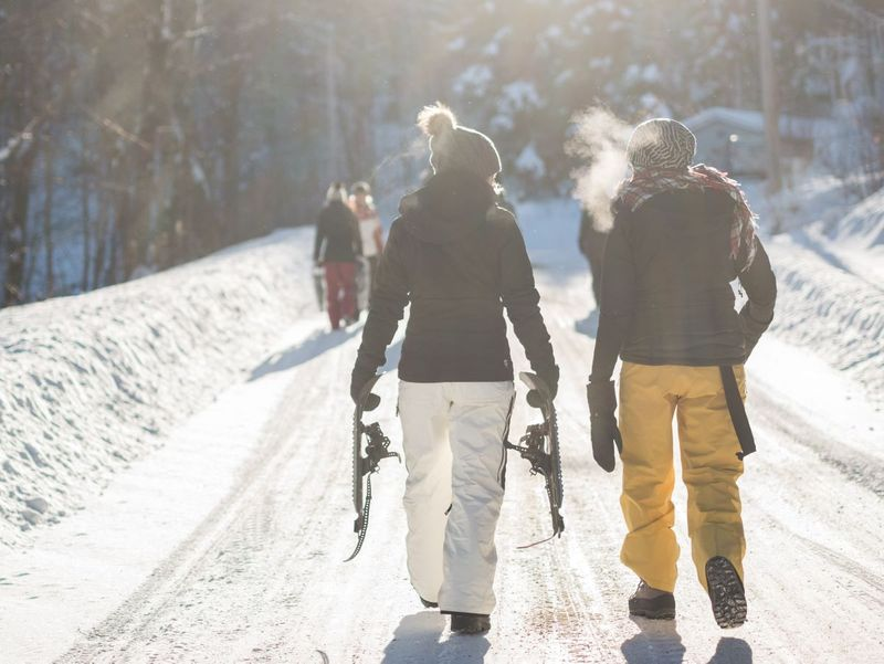 Two people skiing in Canada