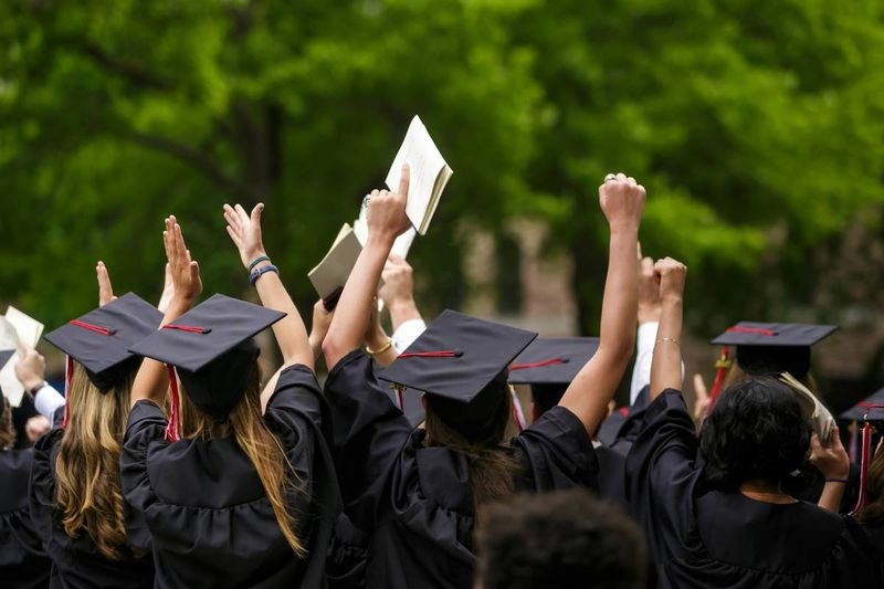 Students at graduation  immigrate to Canada