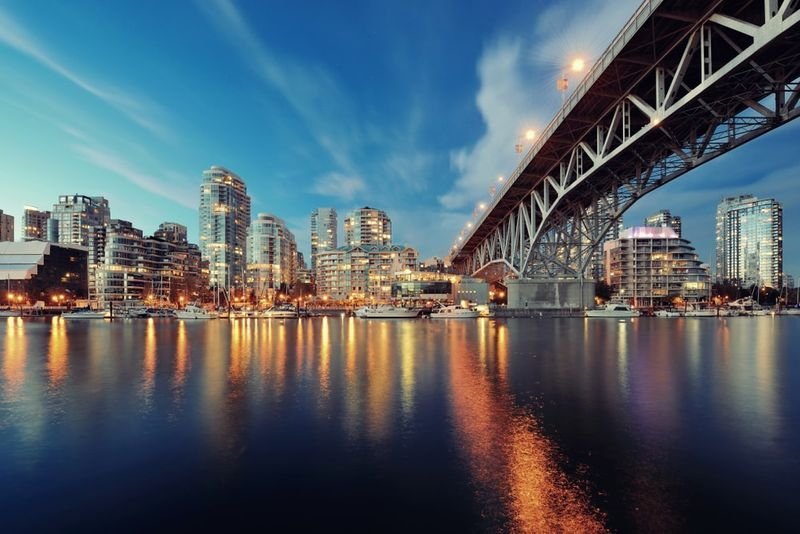 Vancouver False Creek at night with bridge and boat Canada