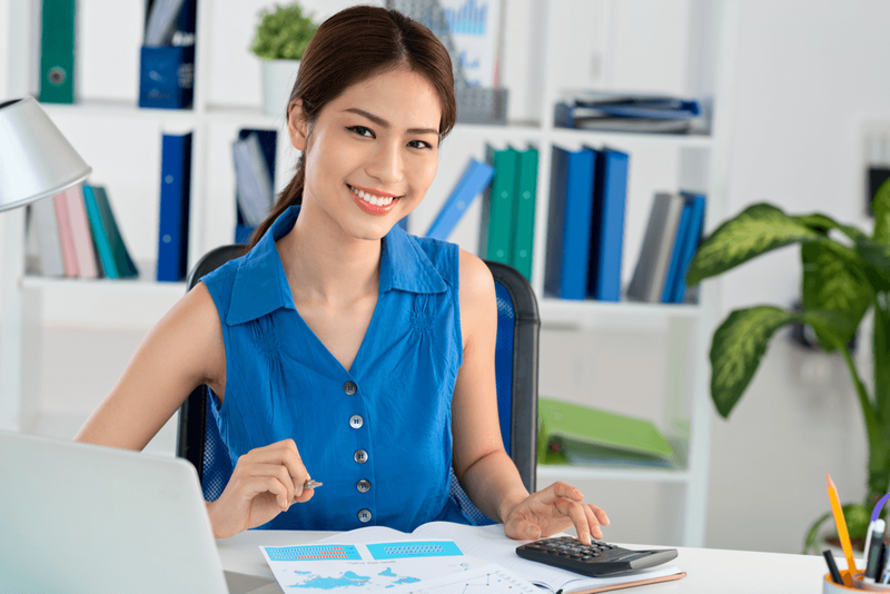 administrative accountant working at her desk
