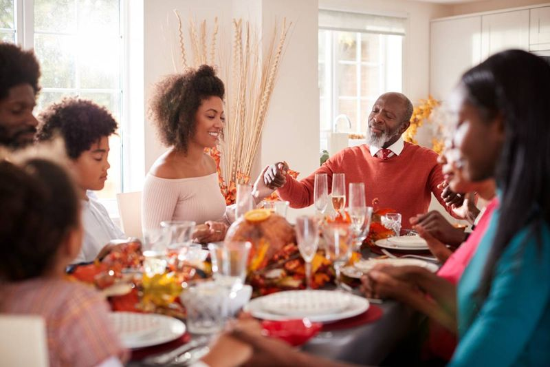 African family celebrating thanksgiving at the dinner table |  how to apply for a Canada visa from the Democratic Republic of Congo