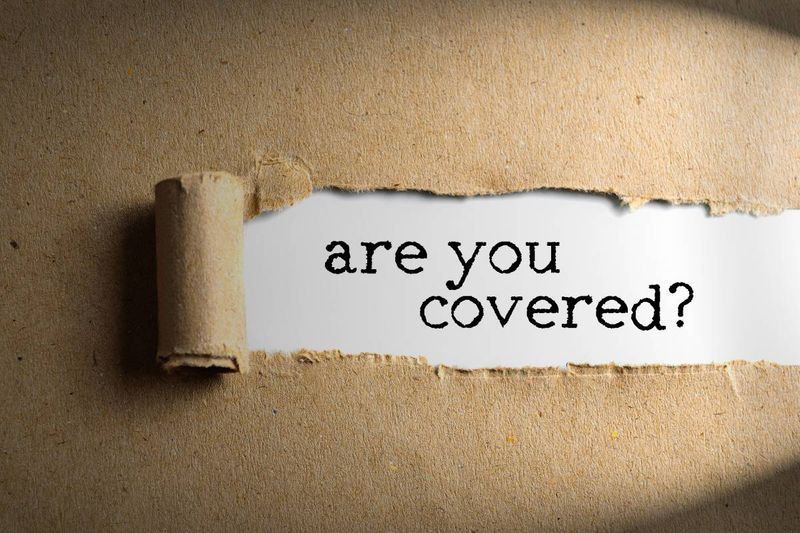 are you covered torn paper insurance concept | business immigration to Canada