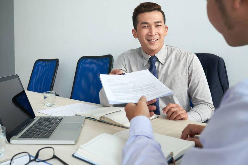 Asian man applying for tech job in Canada