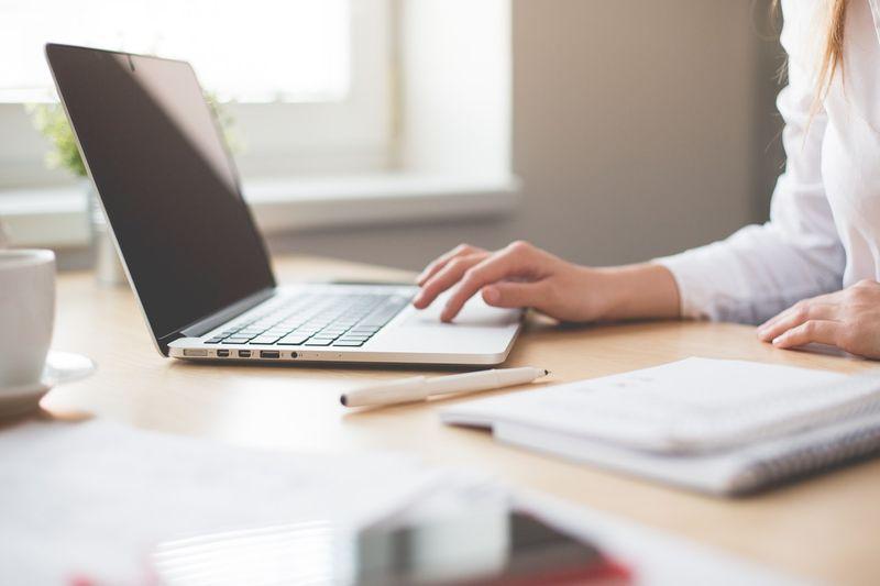 ballpen blur close up laptop applying for Canadian visa