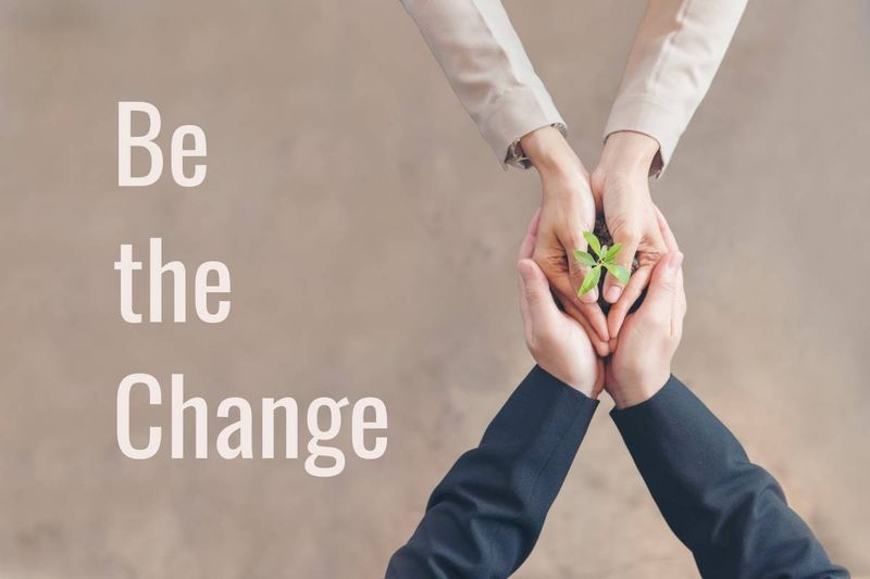 be the change two hands holding plant sustainable business concept | immigrate to Canada