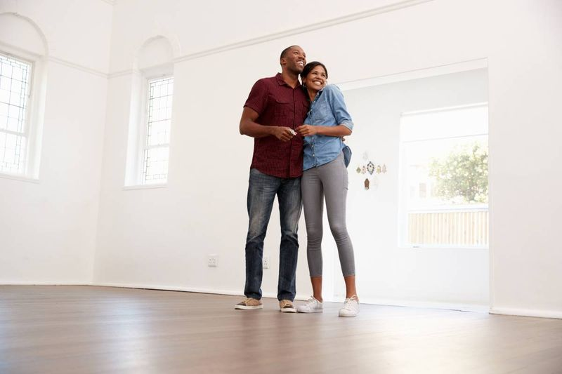 smiling black couple moving into new home in Canada