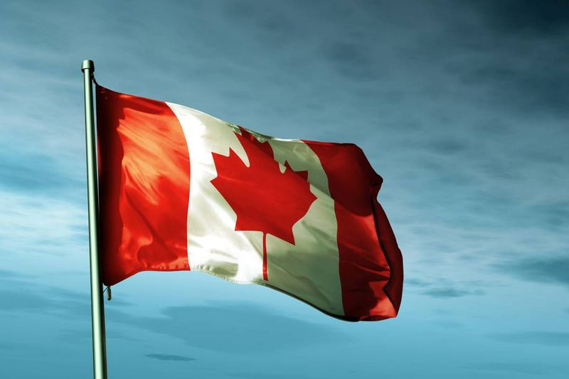 Canada flag blowing in the wind |  work in Canada