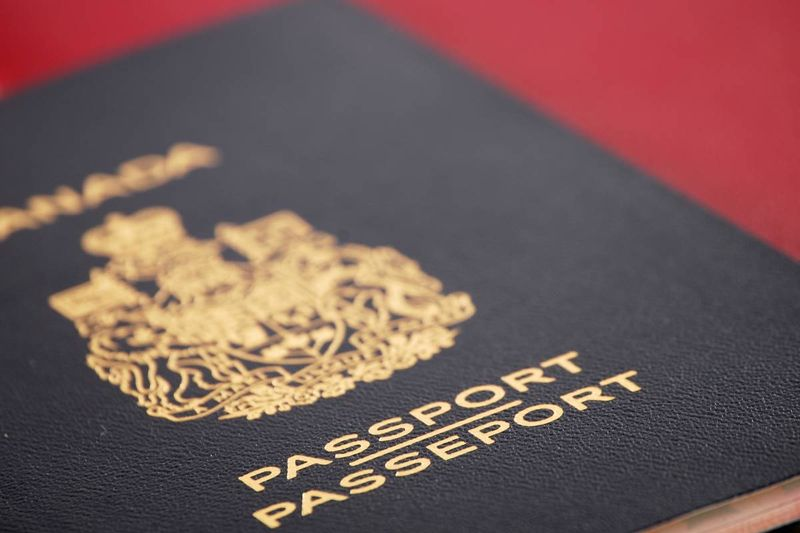 Canadian passport on red background   jobs in Canada