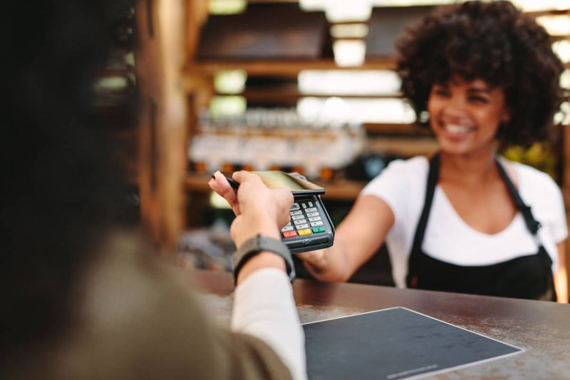contactless payment with phone and card machine | business immigration to Canada