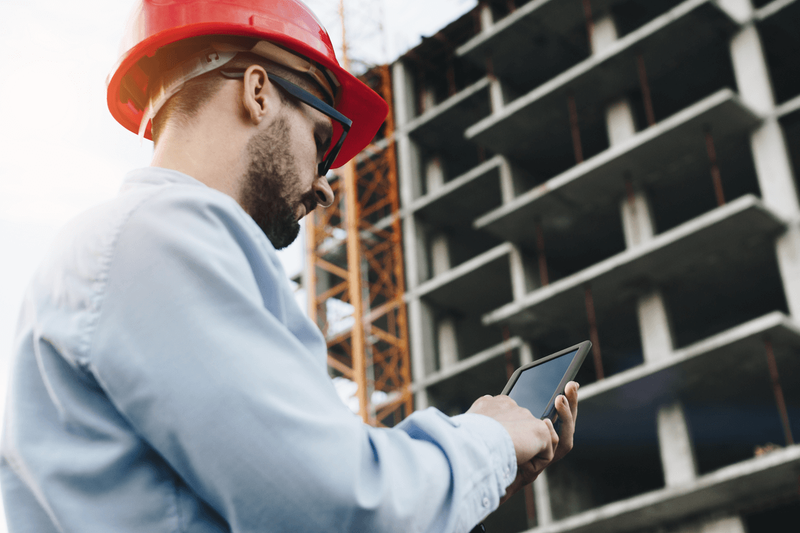 engineer standing on site with tablet