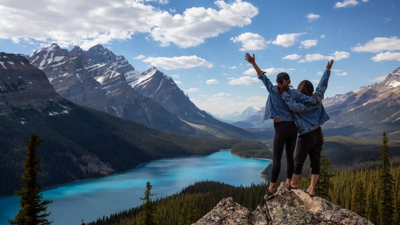 female-friends-Canadian-Rockies-Landscape-view-Peyto-Lake-Banff-National-Park-Alberta-Canada | immigrate to Canada