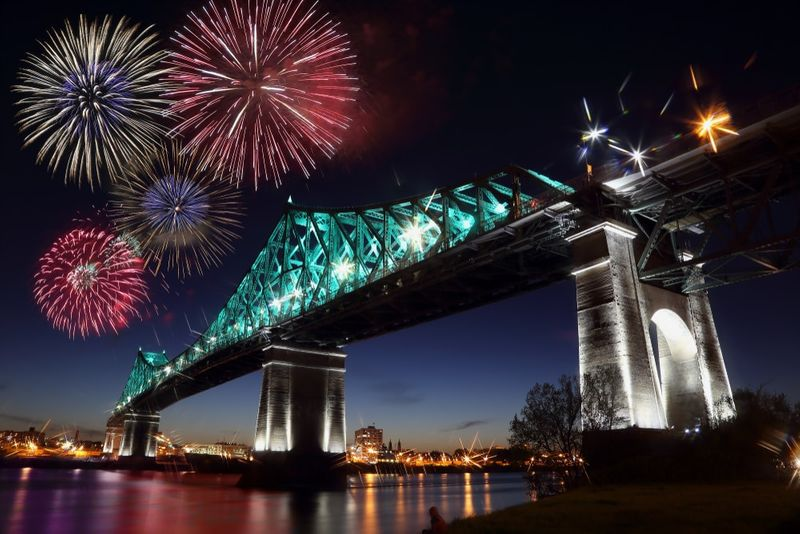 fireworks over bridge in Montreal at night | travel to Canada