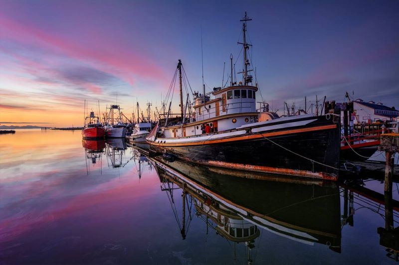 fishing trawler docked in harbour at sunset | migrate to Canada