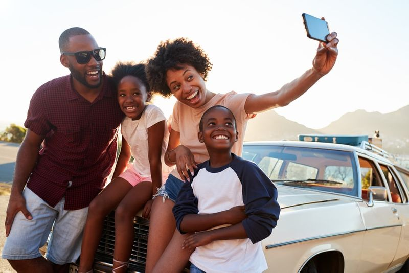 Ghanaian family taking road trip pictures thanks to Canada immigration support.