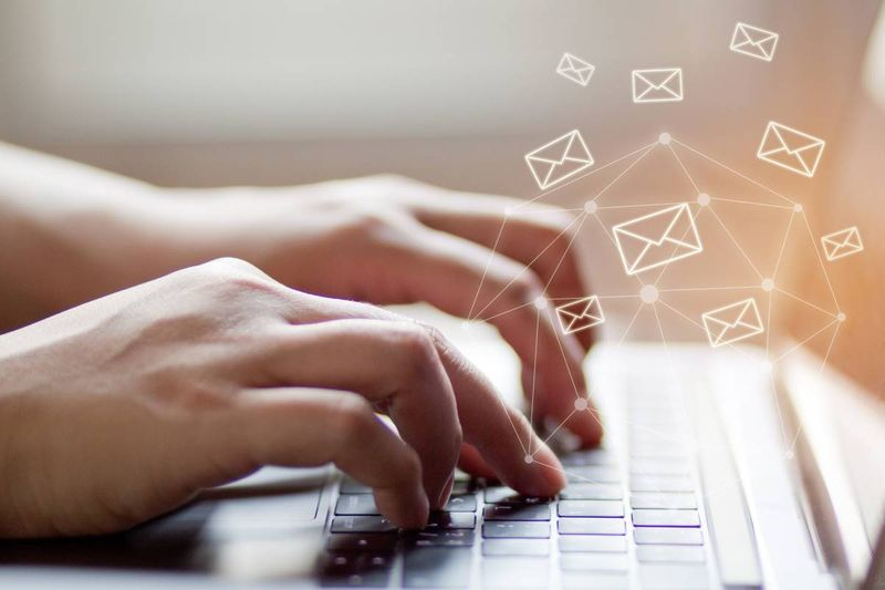 hands typing on laptop send email concept | jobs in Canada