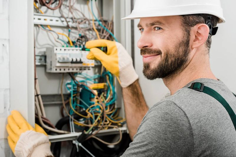 handsome-smiling-electrician-fixing-electrical-box   Canada Express Entry