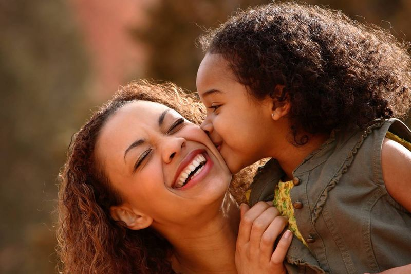 happy-African-American-mother-with-daughter-kissing-her-on-the-cheek   how to apply for a Canadian visa from Kenya