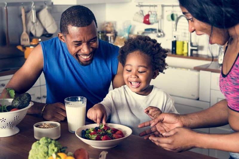 happy African family having healthy breakfast |  how to apply for a Canada visa from the Democratic Republic of Congo