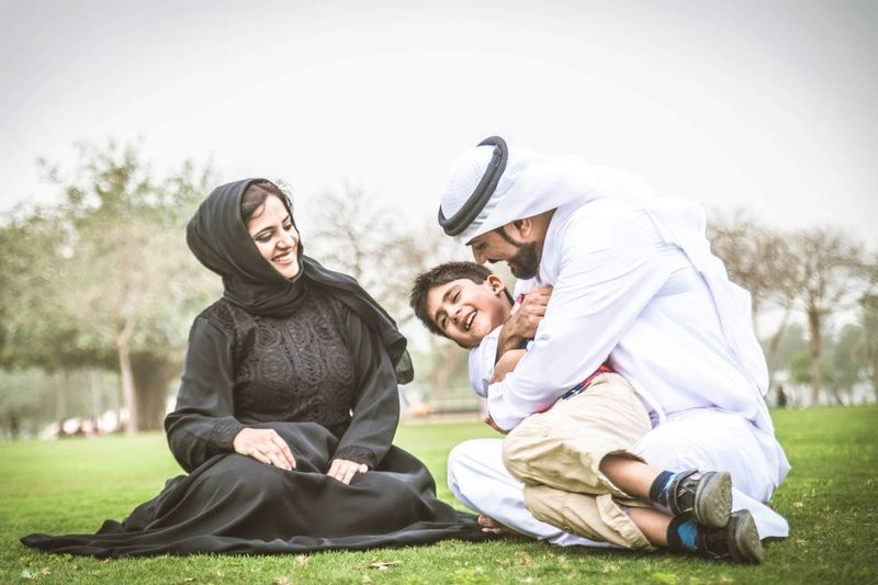 happy Arab family in park |  how to apply for a Canada visa from Qatar