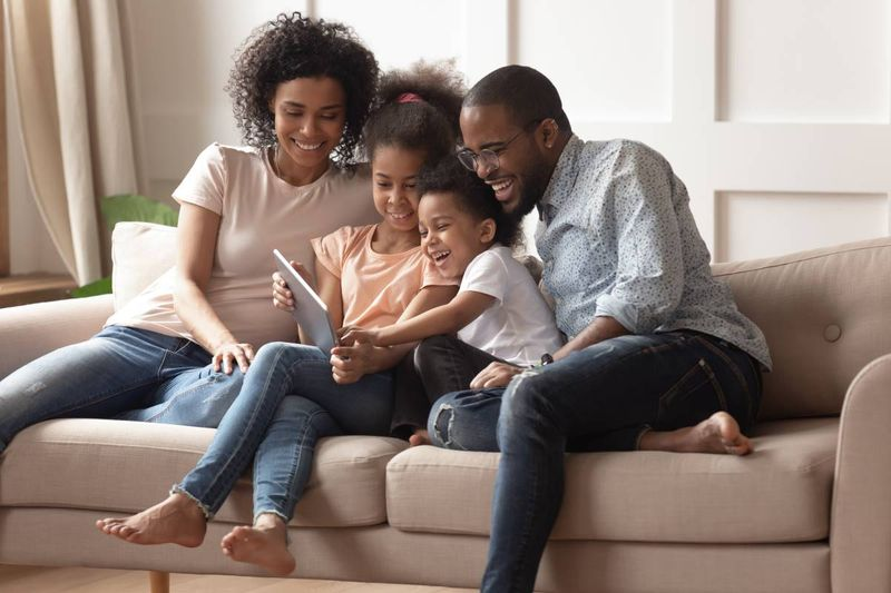 happy-black-people-sitting-on-couch-with-ipad  apply for a Canadian visa from Kenya
