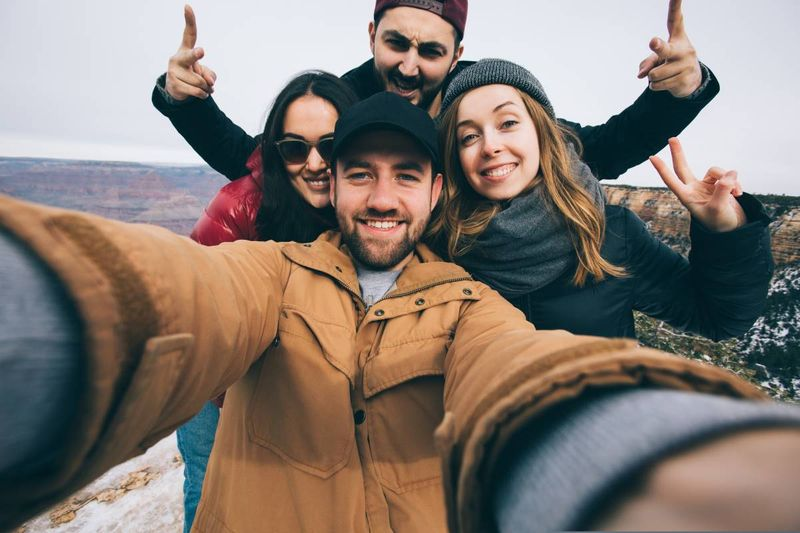 happy-multiracial-travellers-taking-selfie | Canadian Immigration Programs for Turkish Immigrants