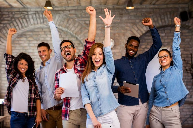 happy people celebrating success | Fastest Ways to Immigrate to Canada