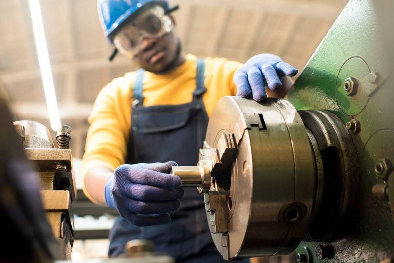 African-american man wearing helmut operating machine  | jobs in Canada