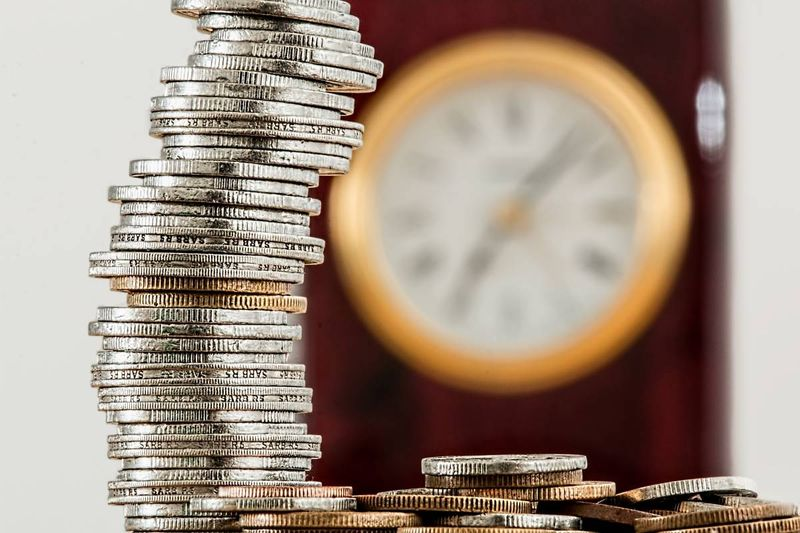 silver and gold coins   how much does it cost to migrate to Canada