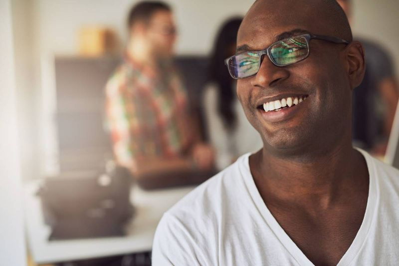 smiling African American man   immigrate in Canada