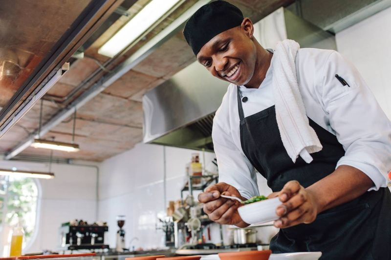 smiling-chef-preparing-food-in-kitchen   Canada Express Entry