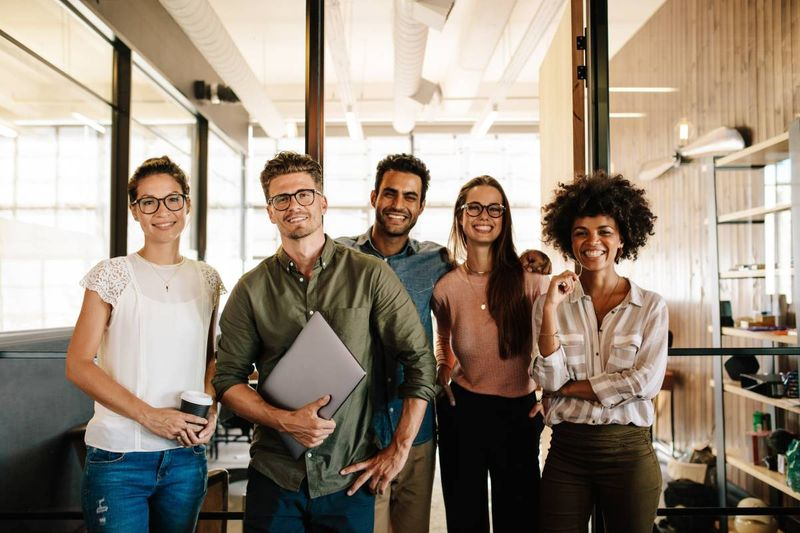 smiling employees after being hired in tech industry | immigrate to Canada