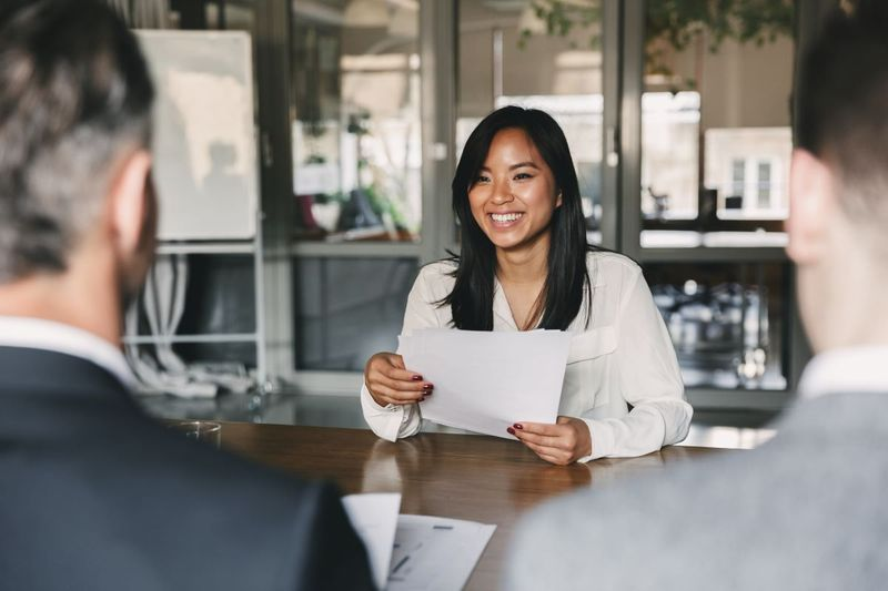 Asian woman applying for visa with RCIC | jobs in Canada